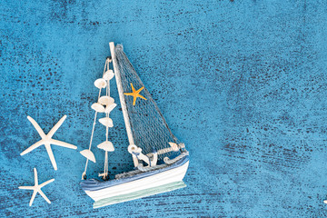Top view Decorative sailing boats and marine items on wooden background.