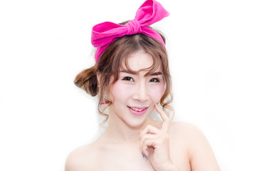 close up the beautiful woman asian look touch her face with pink bow on her hair