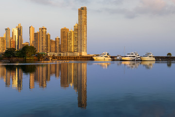 Yacht in a marina with modern buildings on the background at sunset in Panama City, Panama