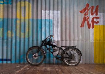 Vintage garage interior with motorbike