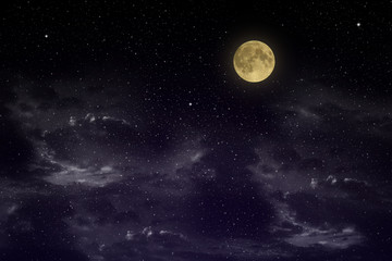 Beautiful magic blue sky with clouds and fullmoon and stars at night closeup
