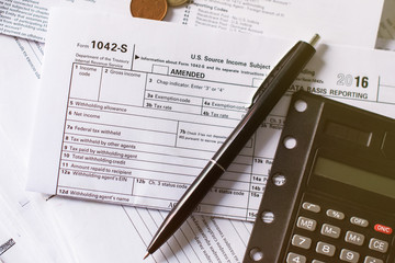 Tax Time Concept! Clock and Taxes Due reminder