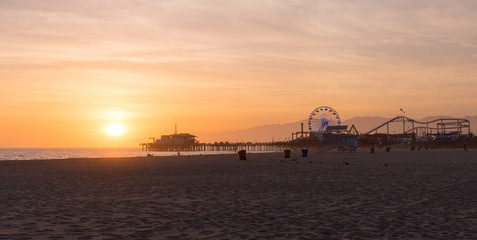 Santa Monica Pier sunset with cloud and orange sky, Los Angeles, USA