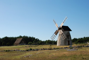 Garden Poster Mills Old house and windmill on Gotland island