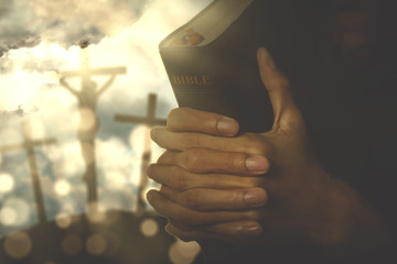 Hands of a Christian man with a bible