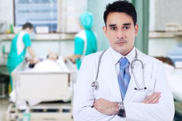 Handsome doctor looks confident