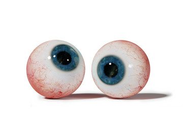 two realistic human eyeballs with blue iris, isolated on white background