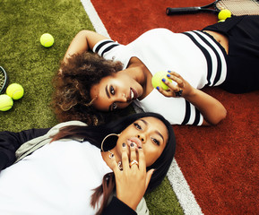 young pretty girlfriends hanging on tennis court, fashion stylis