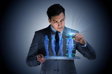 Futuristic remote diagnostics concept with businessman