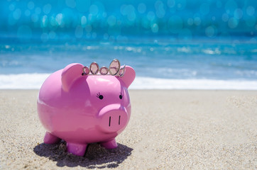 Piggy bank on the sandy beach