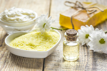 close up body care camomile cosmetic products on wooden desk background