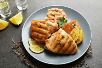 Plate of delicious tequila lime chicken on gray background