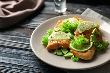 Plate of delicious tequila lime chicken on wooden background