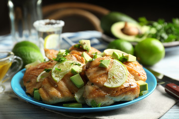 Plate of delicious tequila lime chicken on table