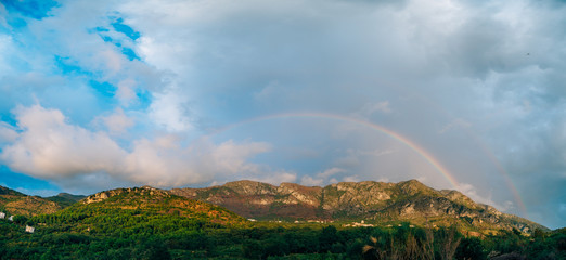 Double rainbow over the mountains. Montenegrin Mountains, the Balkans.