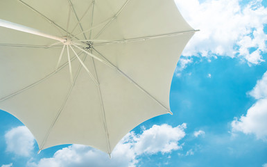 View from under a white beach umbrella