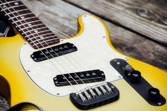 Yellow Electric Guitar on Wood