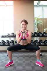 sport woman with dumbbell