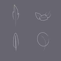 Four white drawing feather on the dark background