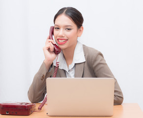 Businesswoman use of notebook. young woman used labtop. young Businesswoman Talking on the phone