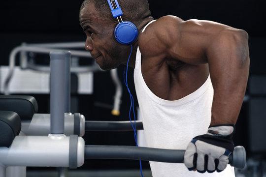 black man doing exercises dips