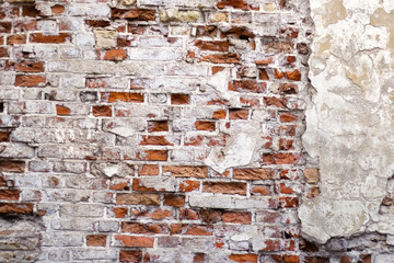 Messy and weathered red brick wall texture.