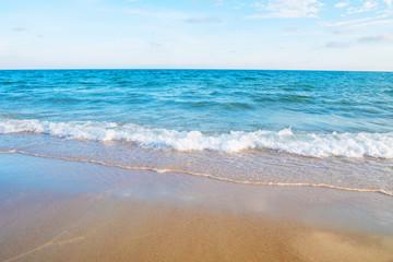 Soft wave on the sandy beach of tropical sea