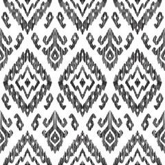 Vector illustration of the black and white colored ikat ornamental seamless pattern. Scribble texture. Design in modern ethic style.