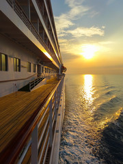 Ocean view with beautiful and romantic sunset from a cruise ship.