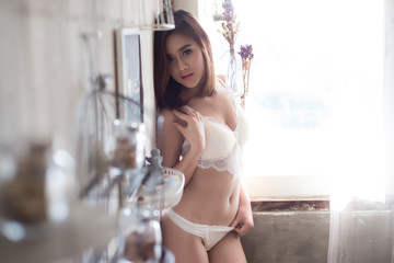 sexy beautiful asian woman in white lingerie