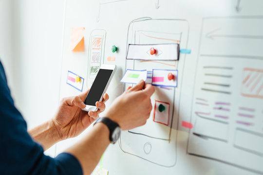 Web designer planning application for mobile phone