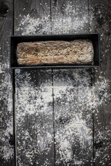Freshly baked wholegrain bread on a wooden table background. healthy , rustic, home prepared  bread.