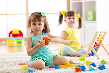 Adorable children playing colorful toys