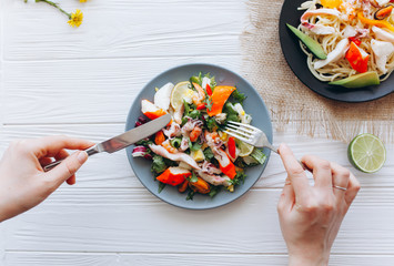 salad and pasta with seafood on wooden background