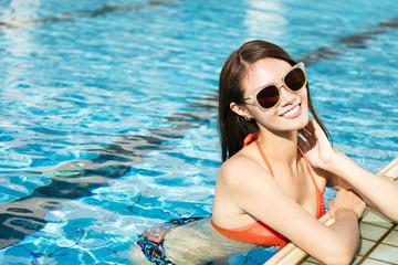 beautiful young woman relaxing in swimming pool