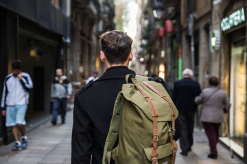 Back view of male tourist in city