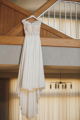 White wedding dress on a hanger.