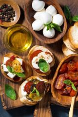 italian antipasti on a cutting board, closeup top view