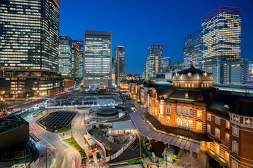 Tokyo railway station and Tokyo highrise building at twilight time in Tokyo, Japan.