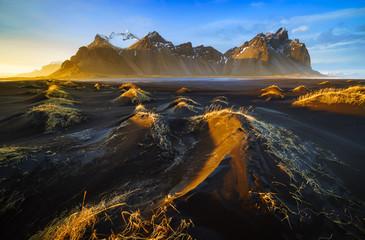 Vestrahorn mountain with black volcanic lava sand dunes at sunset, Stokksnes, Iceland