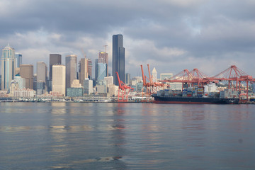 SEATTLE, WASHINGTON, USA - JAN 25th, 2017: A view on Seattle downtown from the waters of Puget Sound. Piers, skyscrapers and harbour docks in Seattle city before sunset on a cloudy day