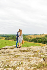 Young couple walk in nature back view