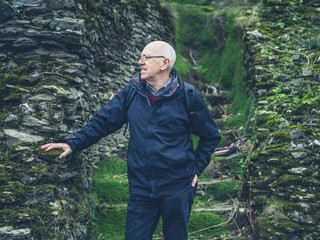 Senior man standing by steps in nature