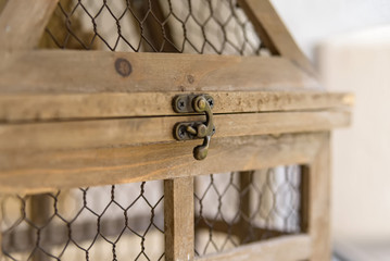 Close up vintage wooden decorative birdcage