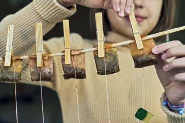 Young girl hanging used tea bags for second use