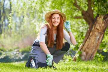 Young beauty at gardening