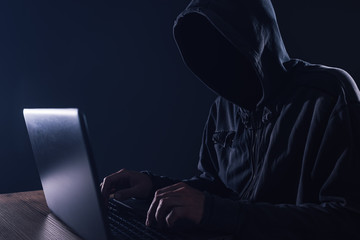 Hacker bypassing hardware firewall on laptop computer