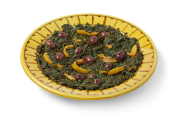 Moroccan dish with spinach, olives and preserved lemon