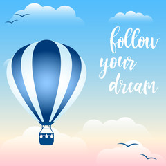 Handwritten quote and hot air balloon floating in the sky among the clouds.