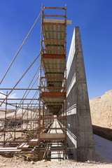 Reinforced concrete wall and scaffolding